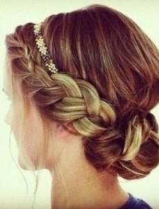 "This look can be achieved by adding one or two braids, loosening them up, and lightly pinning  coiled braid into a bun at the nap of your neck..or slightly to the side. Very chic and relly not hard to ""Holi do!"""
