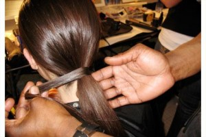 One of Kevin's favorite sleek pony looks is wrapping hair around hair elastic to give a sleek and polished finish to a classic pony.