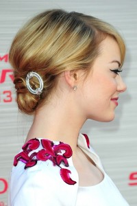 "We love ""Emma's Stones!"" An upswept bob and simple rhinestone barrette at the nape of her neck says effortless style!"